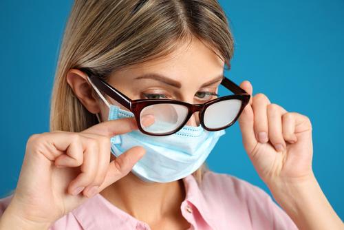 Woman wearing foggy eyeglasses before LASIK